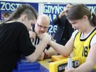 How can you make someone interested in armwrestling?