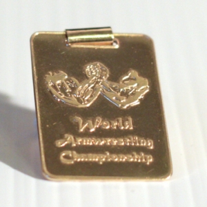 Golden World Armwrestling Championship pendant.